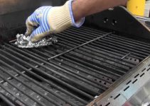 cleaning inside of a gas grill